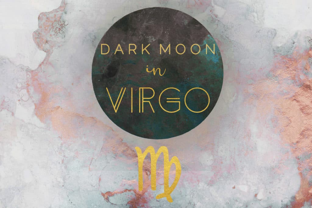 "The words ""Dark Moon in Virgo"" are written over a black circle and above a golden symbol for Virgo, all superimposed on a pink watercolor background."