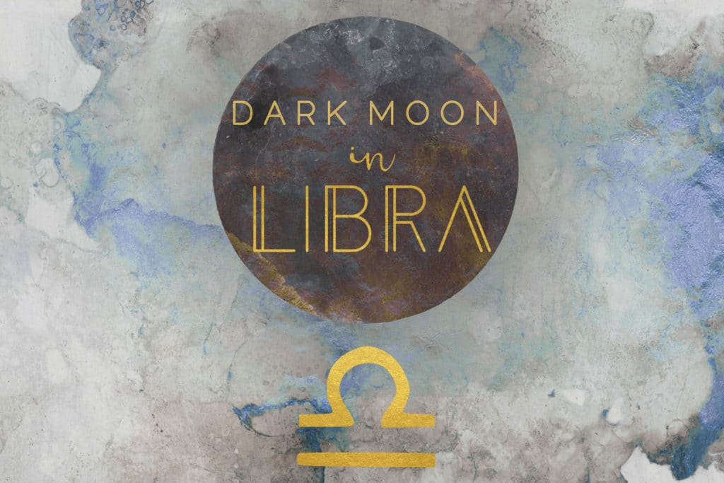 Dark blue watercolor background with a black watercolor moon on the center. The words dark moon in libra are written in gold on the moon, and the libra symbol is below the moon in gold.